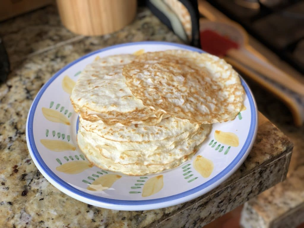 Stack of low carb tortillas on a plate