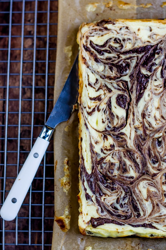 Fancy Keto Brownie Cheesecake Bars swirled and pretty.